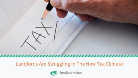 Hand writing the word tax