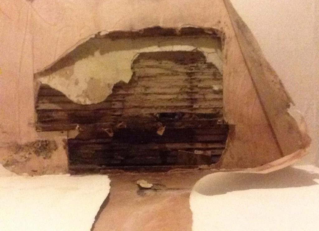 A damp ceiling that has collapsed.