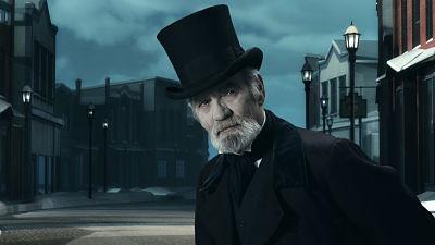 Dickens Scrooge man in old winter street