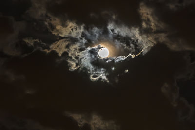 Moon coming through clouds ominously