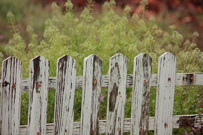 a broken fence symbolising crime
