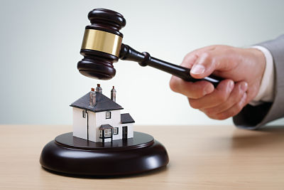 Property under a gavel representing a property auction