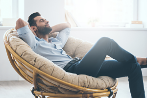 a man sat down relaxing on a chair