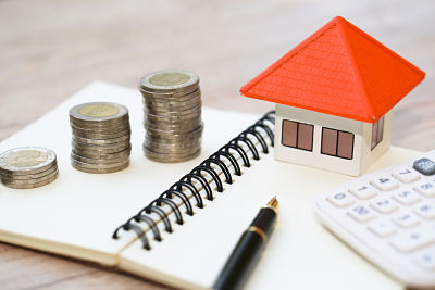concept of saving money for house, Savings money for buy house and loan to business investment for real estate concept. Invesment and Risk Management.