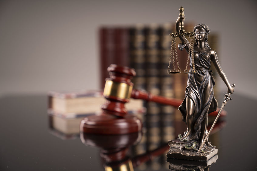 a small statute next to a gavel