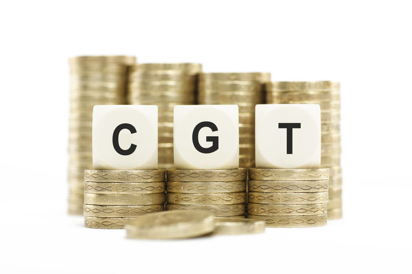 Financial tax planning concept. Letters CGT (Capital Gains Tax) on lettered dice. Taxation of growth and gains on investments, stocks and shares.