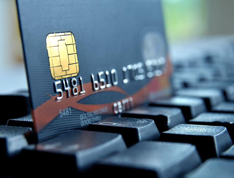 23130965 - credit card on a computer keypad