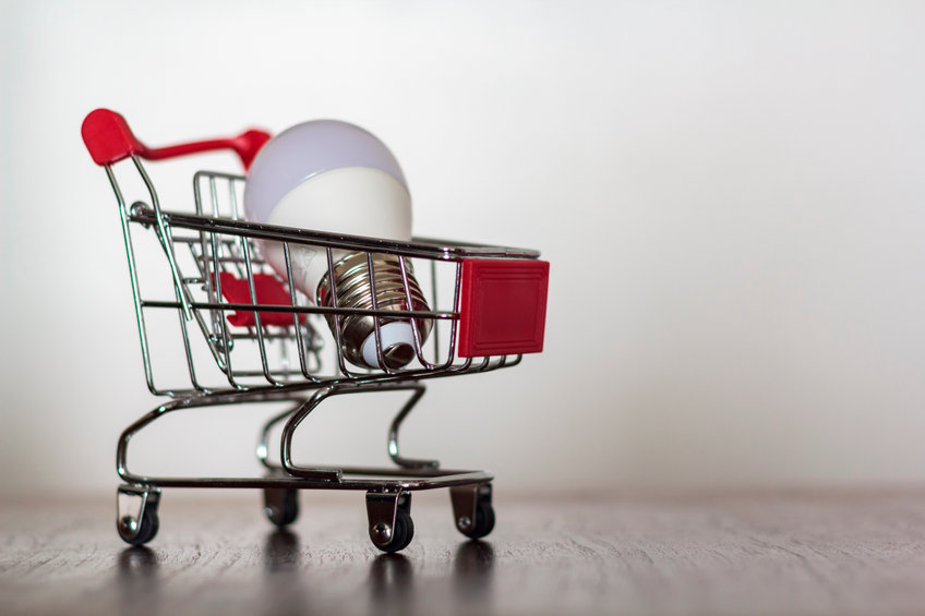 Shopping cart with led lamp on wooden table