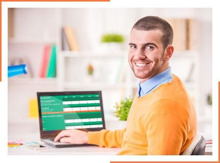 Man using Landlord Vision's income and expense tracker on a computer.